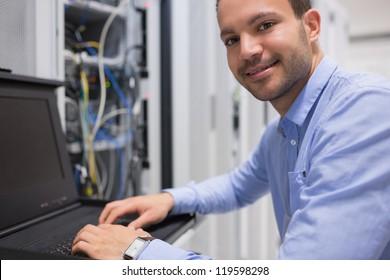 Man searching through servers in data center