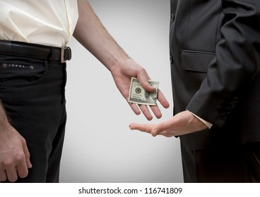 Man secretly giving money to other man