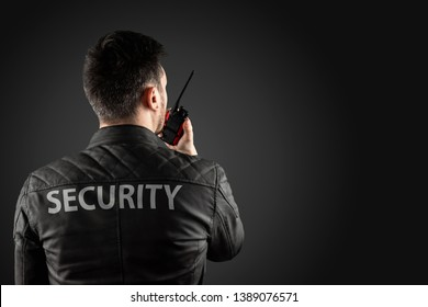 The man, security, is holding a walkie-talkie. The concept of protection, protection of information, bodyguard.
