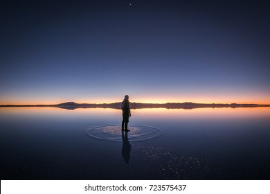 A Man Seeing Sunrise at Salt Flat, Salar de Uyuni, Bolivia