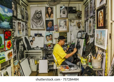 A man is seen focus on his drawing inside his gallery in Kuala Lumpur, Malaysia on November 18, 2017.