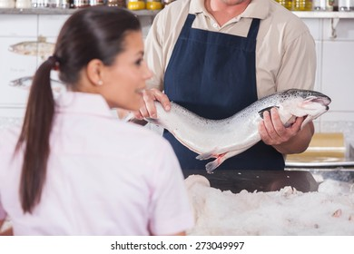 Man selling a pink salmon