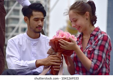 Man send a bouquet of flowers to a woman