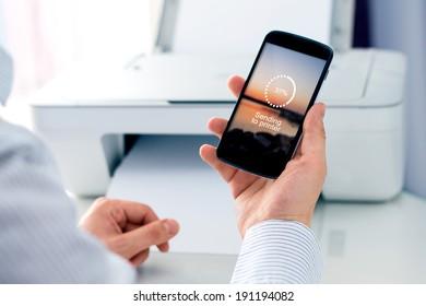 Man sending a photo to wireless printer. Cloud print concept
