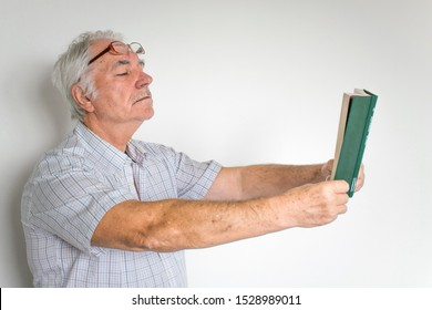 man senior eye with problems read book bad sight treatment help