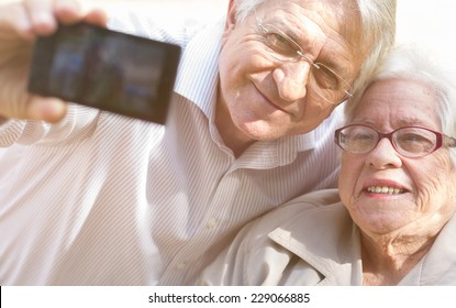 Man and senior woman taking selfie with retro filter effect
