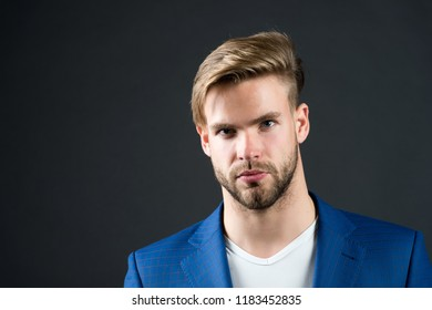 Man serious bearded unshaven guy with perfect hairstyle dark background. Simple hacks to make hairstyle better. Use right product styling hair. Confident with tidy hairstyle. Barber hairstyle tips.