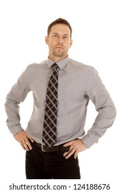 A man with a serious expression on his face wearing a tie and is ready for work.