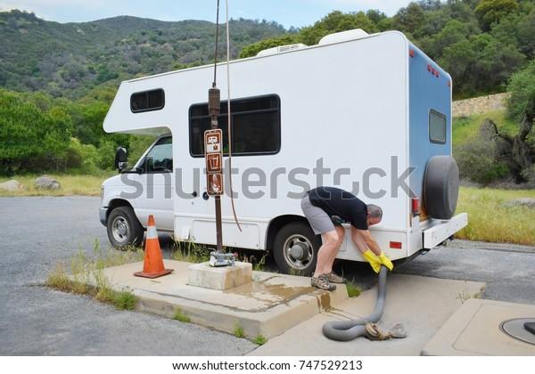 Man Serving Recreational Vehicle Dumping Station Stock Photo