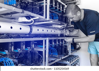 Man setting up a cryptocoin mine, Crypto currency mining concept