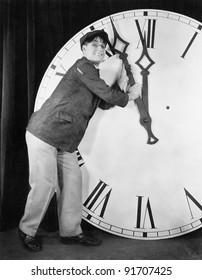 Man setting time on a big clock