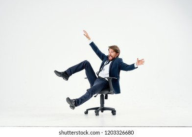 man settled on a chair riding