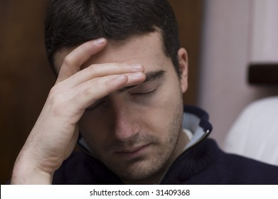 a man with severe headache or depressed