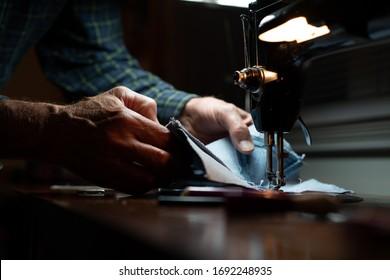 Man sewing machine denim, hands