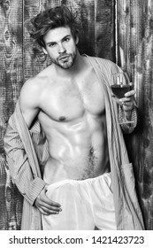 Man sexy chest sweaty skin hold wineglass. Macho tousled hair degustate luxury wine. Drink wine and relax. Bachelor enjoy wine. Erotic and desire concept. Guy attractive relaxing with alcohol drink.