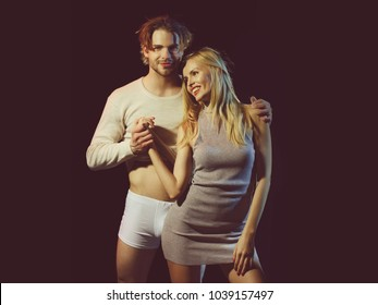 man, sexy guy in underwear pants and pretty girl with pink lips, manicure and blonde hair, happy couple in love on black background, family