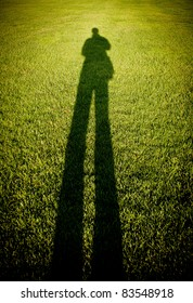man shadow on grass