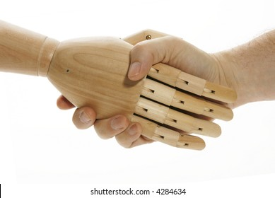Man shaking hands with mechanical wooden arm.