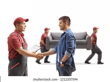 Man shaking hands with a removal guy, movers carrying a couch isolated on white background
