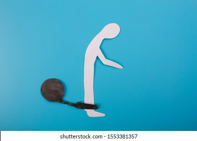 Man in shakles. Paper man in shakles slave concept