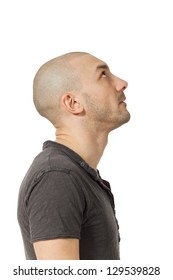 man with shaved head in profile position