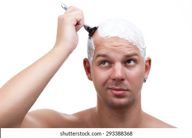 a man shaves his head thoughtfully