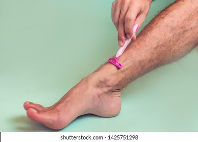 Man shaves his leg isolated. People, healthcare and beauty concept