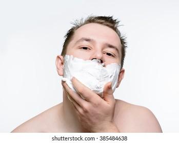 Man shaves shaving foam on a white background