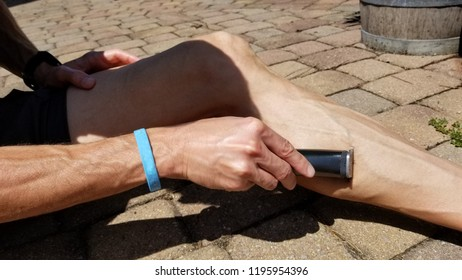 man shaving legs for a race