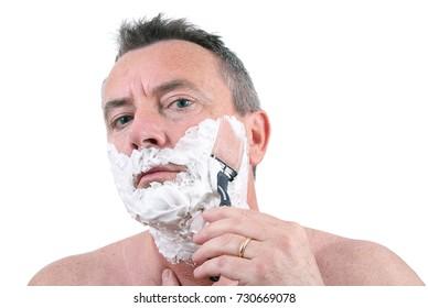 a man shaving with razor
