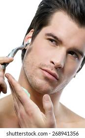 Man shaving with safe razor over white background.