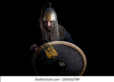 man with a shield and sword of the Viking Age