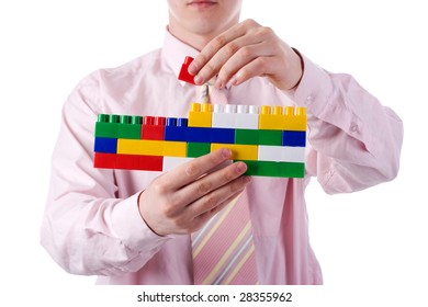 man in shirt with color toy bricks