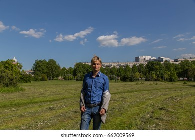 A man in a shirt is holding a jacket