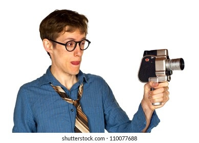 Man with shirt and tie and glasses looking through a hand-held vintage movie camera, isolated on white background.