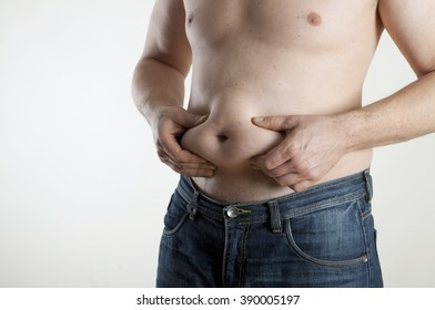 man shirtless holding his belly, white background