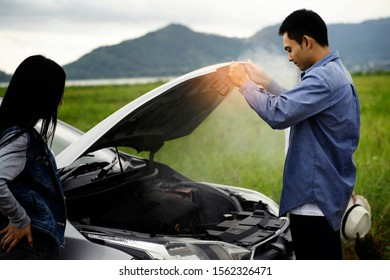 The man was shocked after opening the bonnet with smoke from the engine.car breakdown on the road.