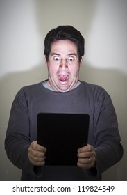 Man is shocked by what he sees on a digital tablet