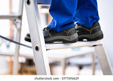 Man In Shoes Climbing Step Ladder. Safety And Insurance