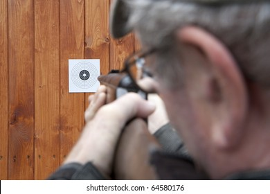 Man shooting with air gun