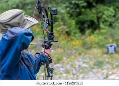 A Man Shooting a Compound Bow