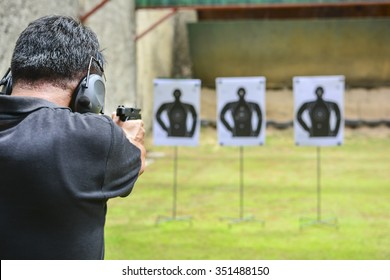 the man shooting with gun