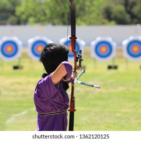 Man shooting with his bow in a competition