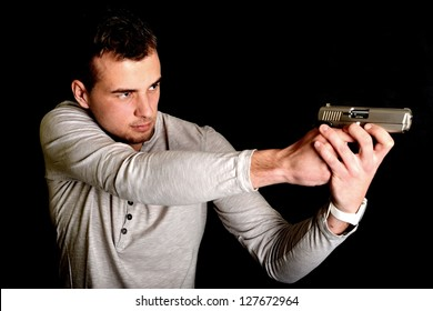 man shooting on a black background