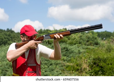 Man shooting skeet with a shotgun