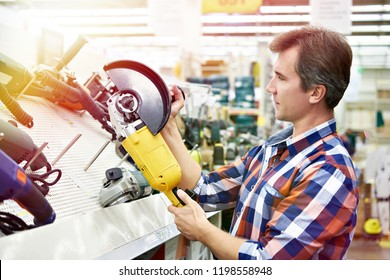 Man shopping for angle grinder in hardware store close-up