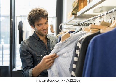 Man shopping, bought shirt in a fashionable shops