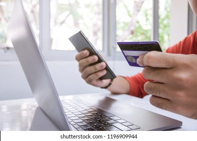 A man shopping online with smartphone and credit card, Online payment, E-commerce