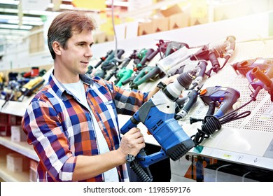 Man shopping for perforator in hardware store close-up