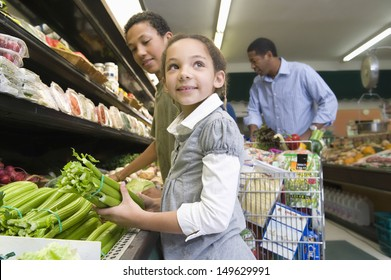 Man shopping with son and daughter in the supermarket
